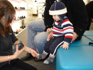 toddler getting new shoes