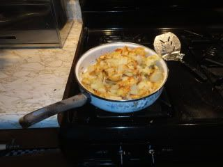 potatoes in a skillet on the stove