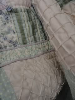 a multi-textured bed quilt, close up of loose folds