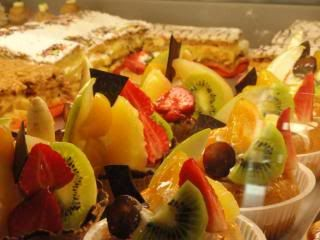 fruit tarts and little cakes, in French bakery