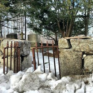 photo old iron gate, hanging open, in a stone wall in a cemetery in New Hampshire.jpg