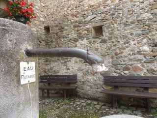 ornate water spout in medieval village