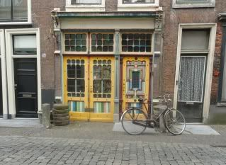 antique storefront, bicycle, cobblestone street