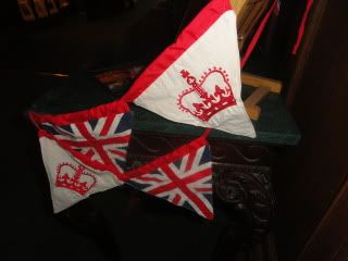 bunting, hand embroidered crowns, and appliqued Union Jacks, on triangular dags, put out for the Diamond Jubilee, but originally made for Queen Elizabeth's coronation