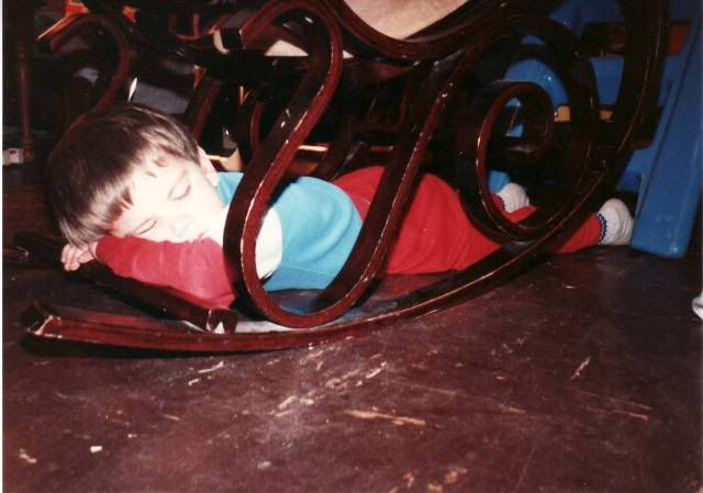 Kirby Dodd age five asleep under a rocking chair