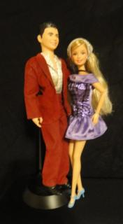 Ken and Barbie, posed with black background