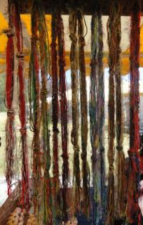 hand-spun and died yarn, hanging for sale at an outdoor fair