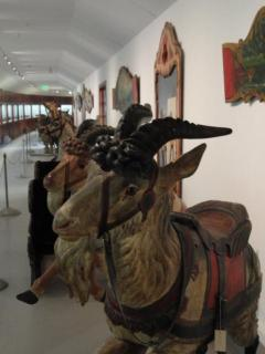 carved wooden goats, once on a carousel