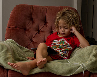 child watching shows on tablet