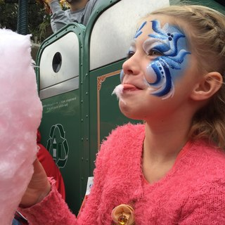Happiness stacking - eating candy floss while waiting for the parade wearing beautiful make up and a Belle dress