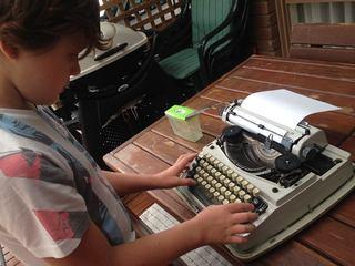 boy with a manual typewriter