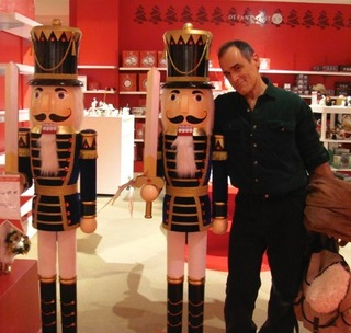 Two Nutcrackers and One Nut--a husband next to tall figures of nutcrackers