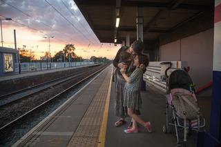 mother, child, infant, on empty platform at train station