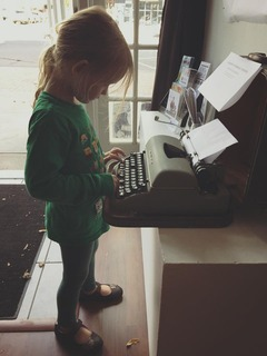child using a typewriter