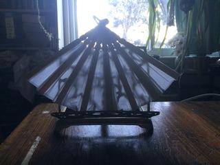light shining through a cloth hand fan