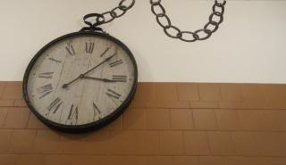 wall clock with chain to look like giant pocket watch