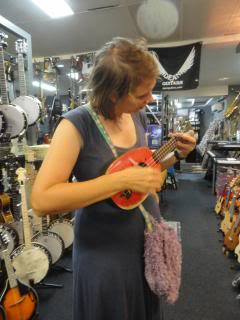 Schuyler playing a ukelele in a music shop