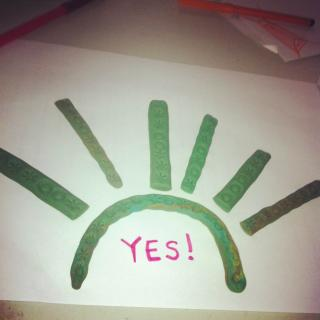 painting of a sort of sunburst, with the word 'yes'