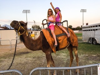 two girls on a camel