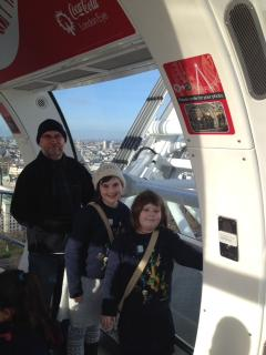 dad and two daughters on a giant wheel