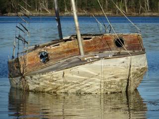 old sailboat, listing, nice reflection