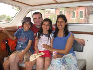 Dusseldorp family, in a boat