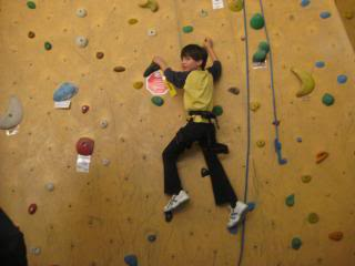 child on a an indoor climbing wall