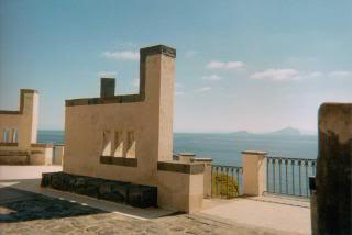 Ginostra, on Stromboli; walls, railing, sea, mountains, sky
