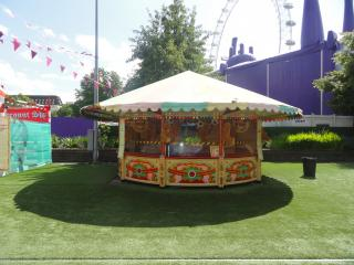 round carnival booth with big shadow