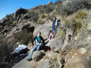 Holly, Adam, and James, climbing foothills of the Sandias