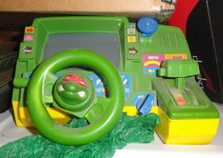 Ninja Turtle pretend-driving toy with s steering wheel and shifter