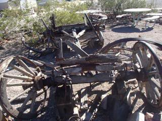 old wooden wagons, falling apart, broken wheels, in the desert in Nevada