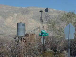 rural Nevada, water tower, windmill vane and base, street sign, mountains