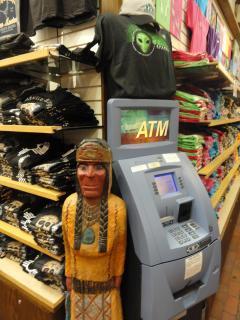 wooden Indian, alien t-shirt, cash machine; tourist shop in Albuquerque