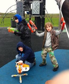 three boys, playground, toy guns
