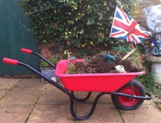 red wheelbarrow, with dirt, toys, Union Jack