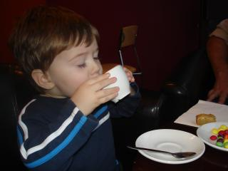 Adam, young, drinking tea