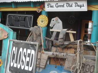 signs, rope, saddle, rocking horse, outside an antique store