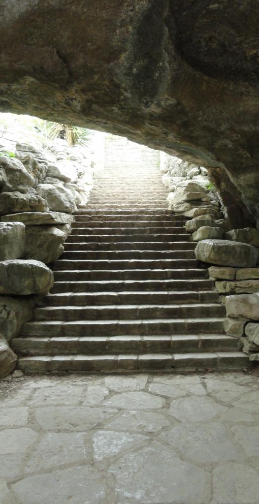 stairs up out of a small cavern