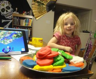 girl with her playdough food