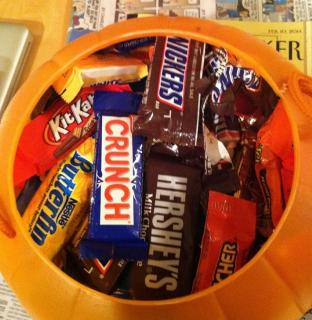 plastic jack-o-lantern full of candy bars