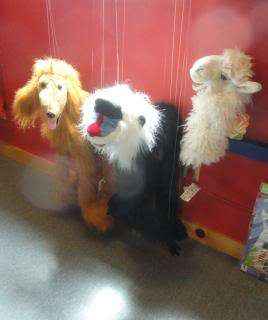 long arm puppets, in a shop