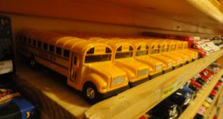 matching toy school busses, on a store shelf