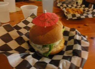 burger with paper umbrella stuck in the top