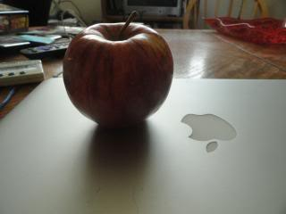apple on top of a macbook