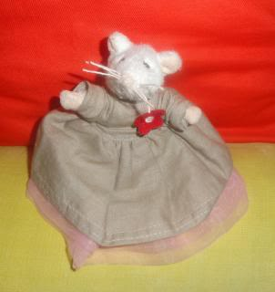 stuffed toy mouse in a long dress