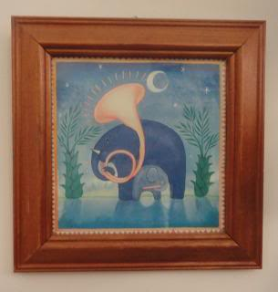 framed illustraion of a sousaphone-playing cartoon elephant in moonlight