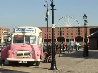 an ice cream truck in Liverpool, ferris wheel in the background