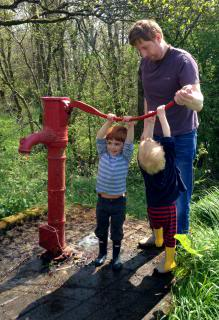 photo hand pump, two young boys and dad.jpg