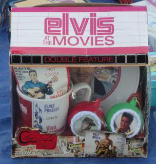 vintage Elivs fan mug, saucer, two Christmas ornaments, little stickers?  In the original box, which says 'Elvis at the Movies'